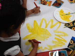 Painting sunflowers at Tinsley Meadows Primary Academy.