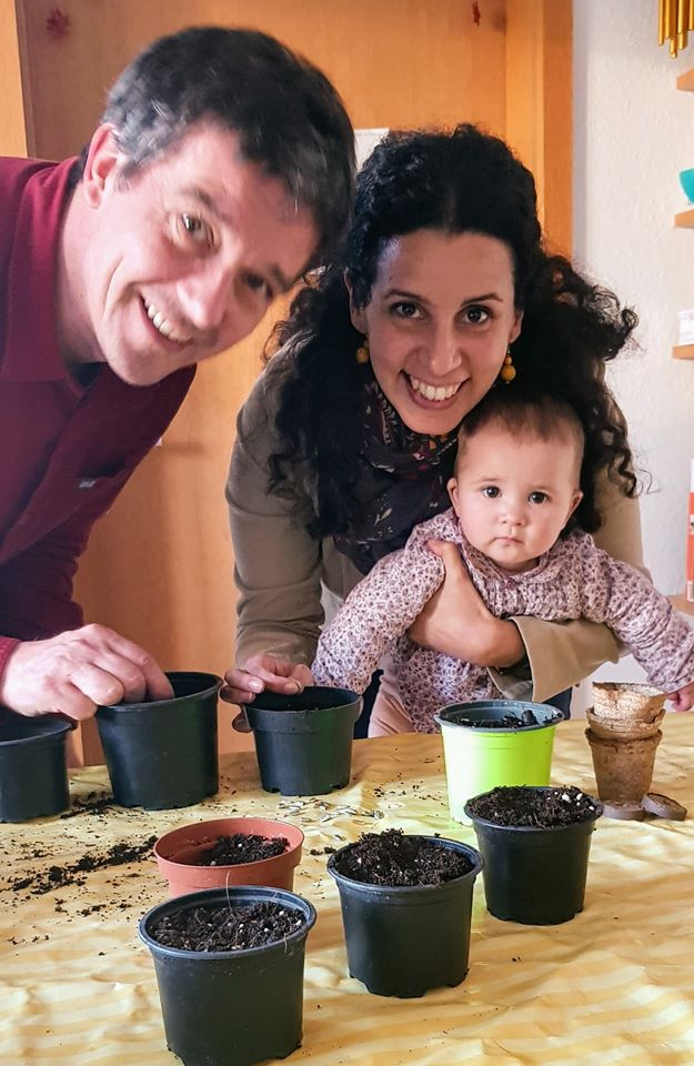Jen and Holger planting sunflower seeds in Germany.